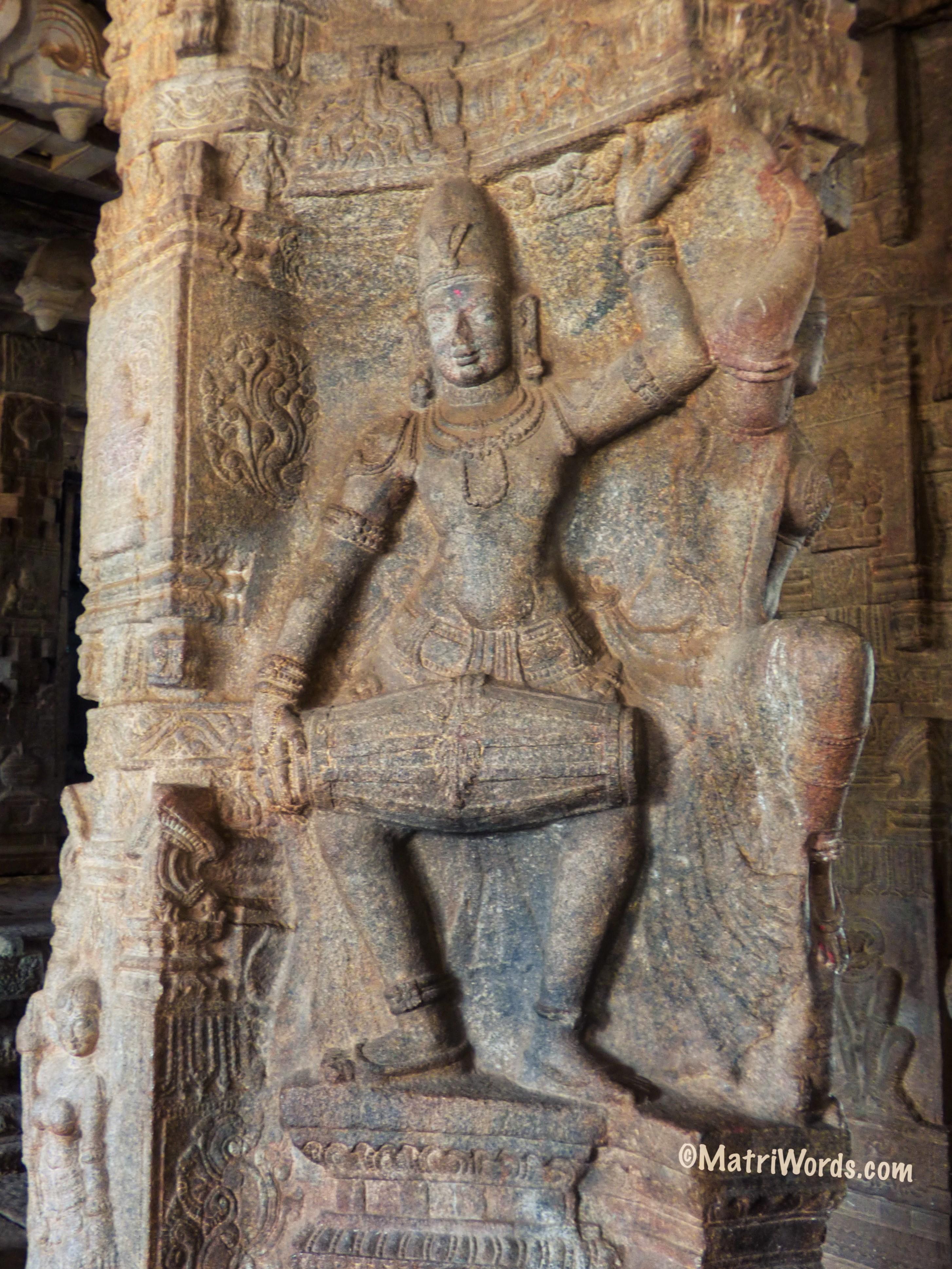 Shiva playing mridangam